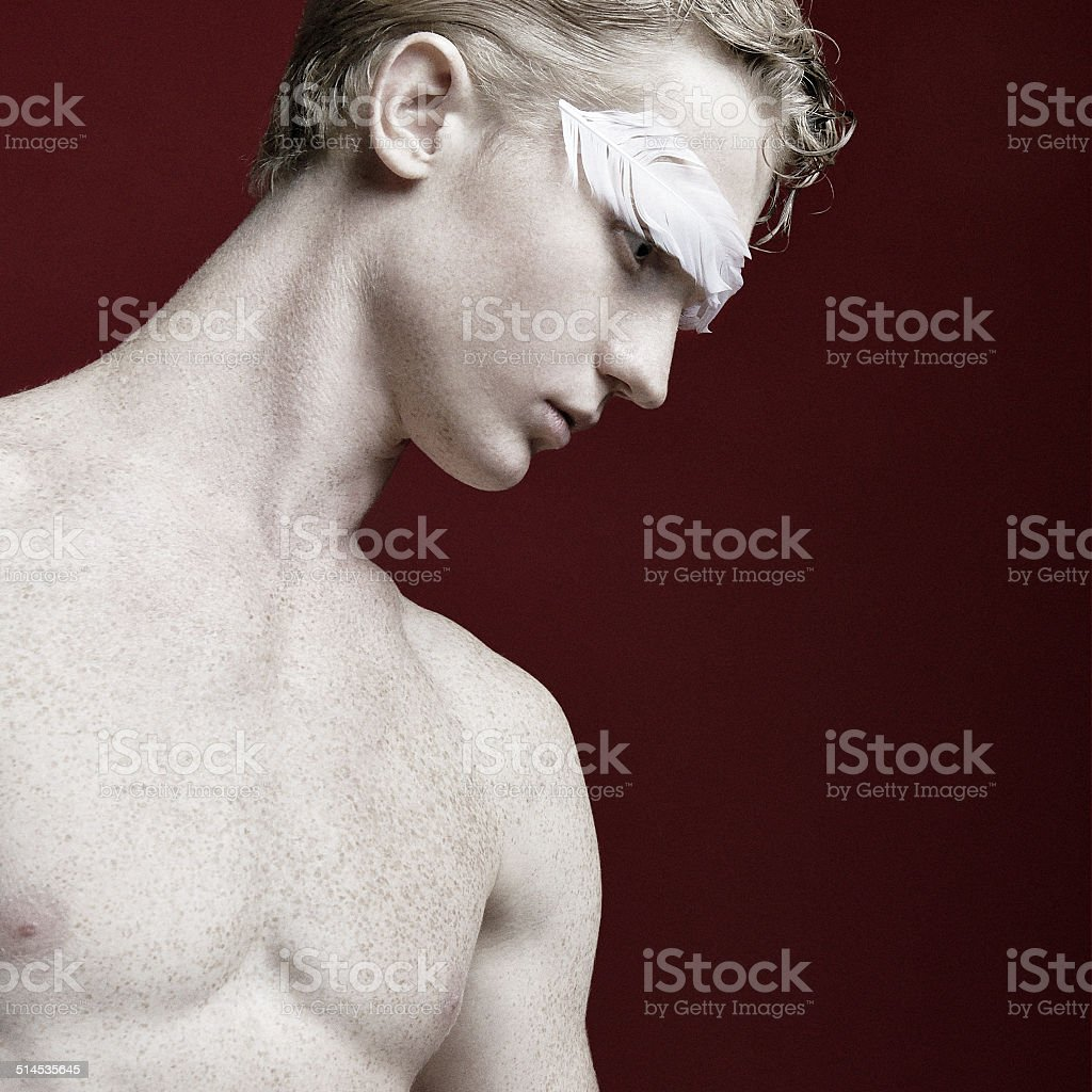 Boy with feather on his eyebrows royalty-free stock photo