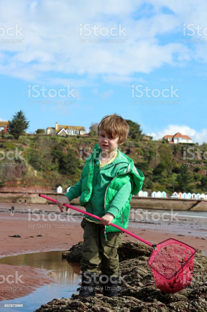 Boy with fishing net stock photo