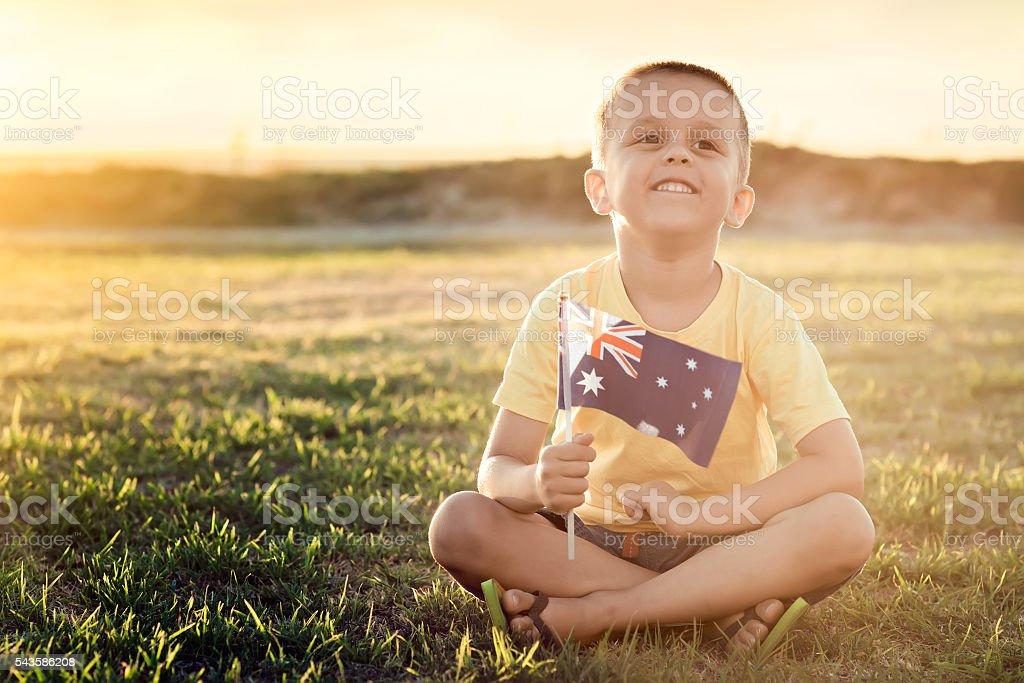 Boy with flag on Australia day stock photo
