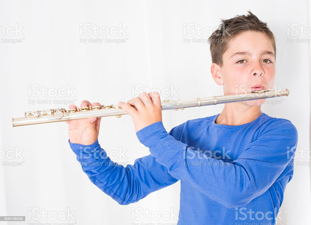 boy with flute stock photo
