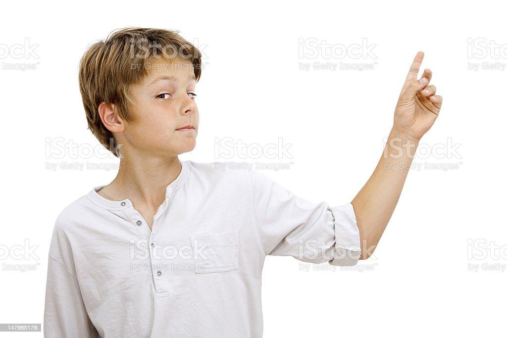 Garçon avec l'expression du visage drôle de doigt. photo libre de droits