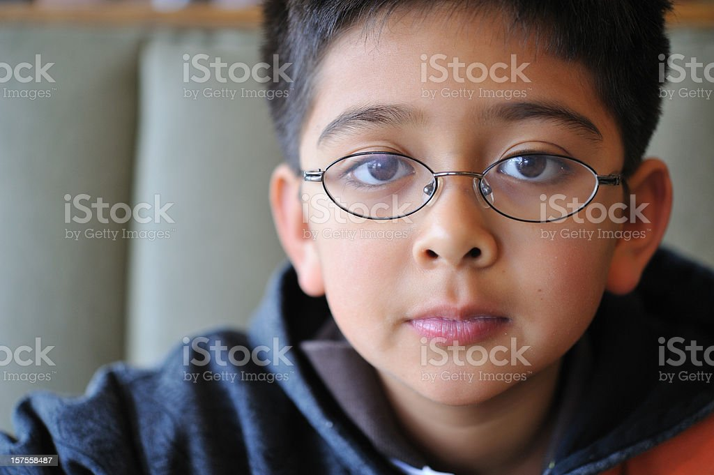 Boy with glasses looking at the camera stock photo
