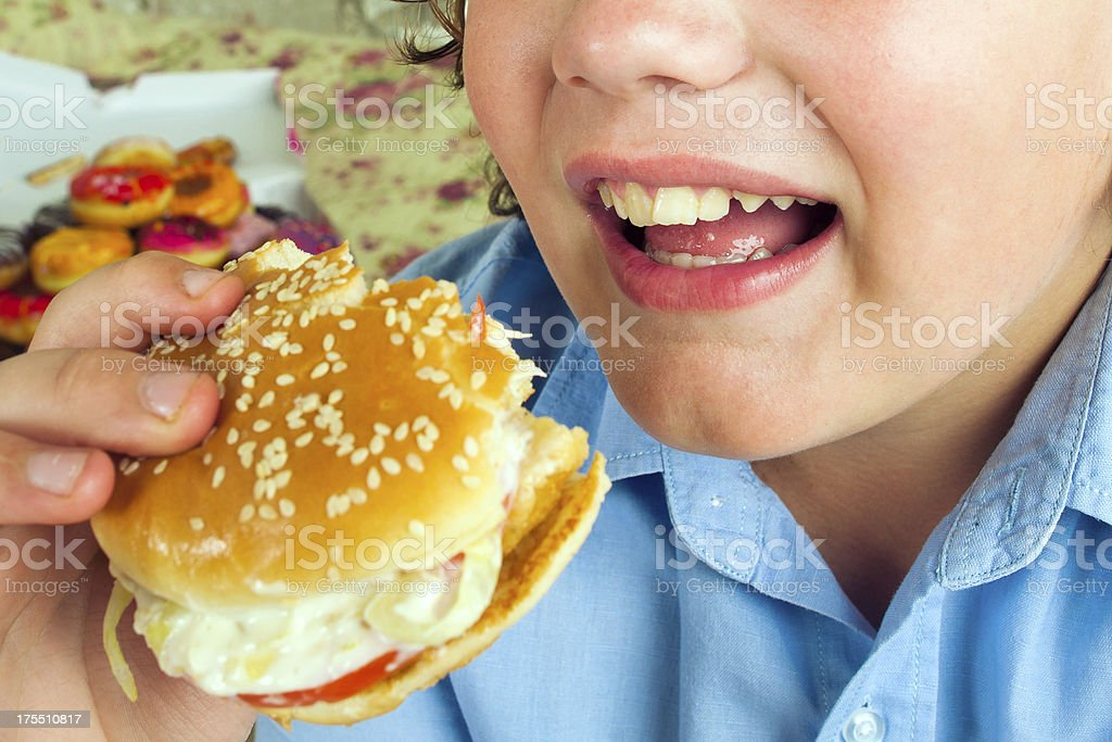 Boy with hamburger stock photo