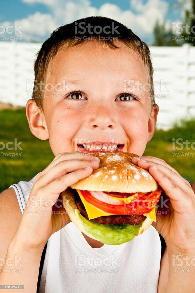 Boy with Hamburger royalty-free stock photo