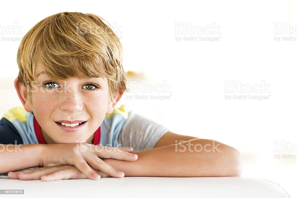 Boy With Hand On Chin Relaxing At Home royalty-free stock photo