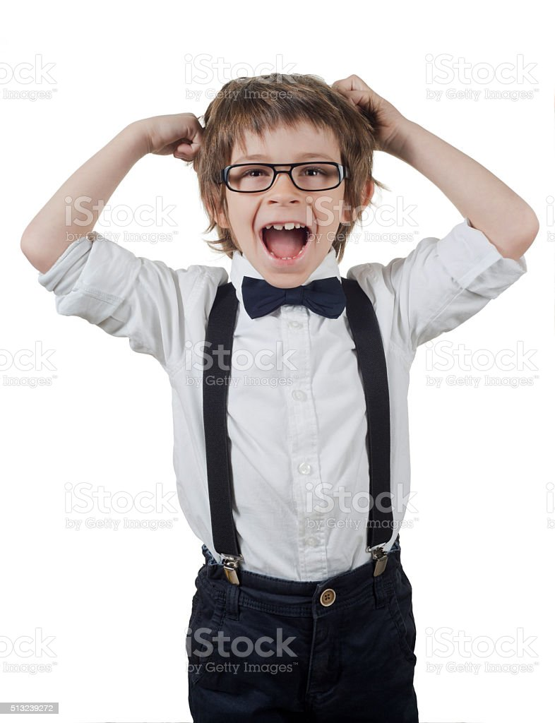 boy with hands on head shouts stock photo