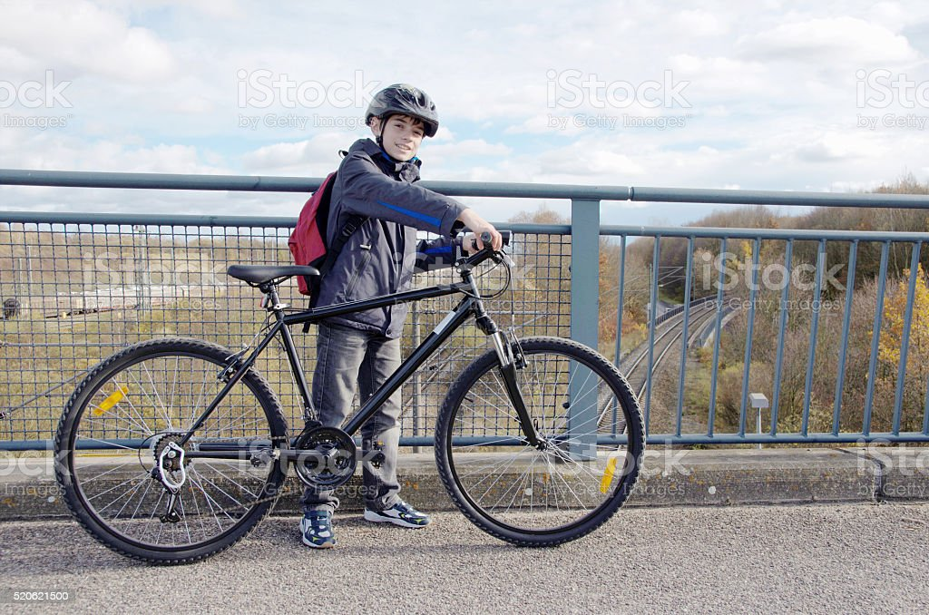 Boy with helmet riding bicycle royalty-free stock photo