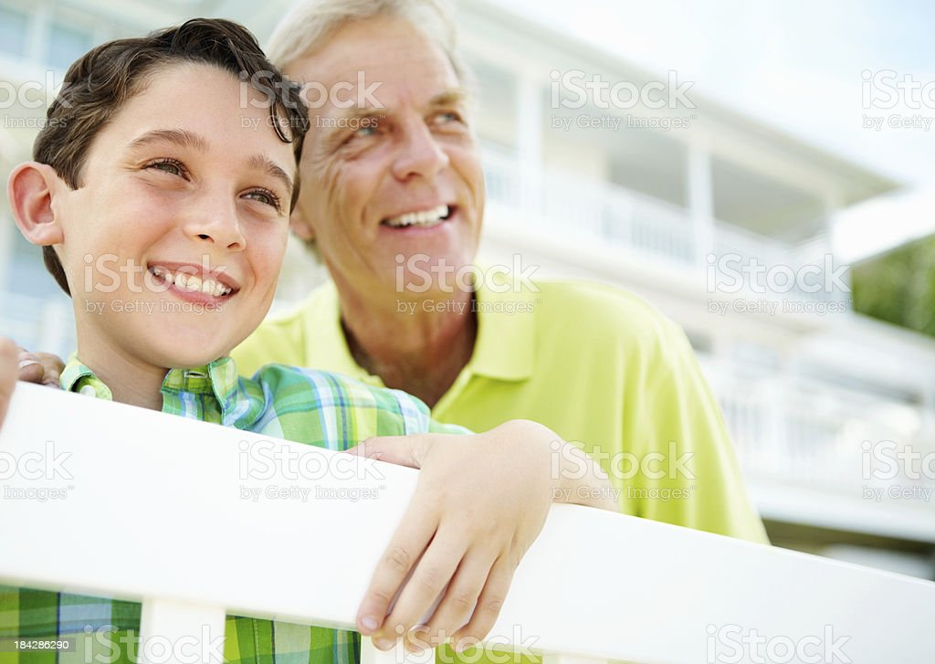 Boy with his grandfather looking away royalty-free stock photo