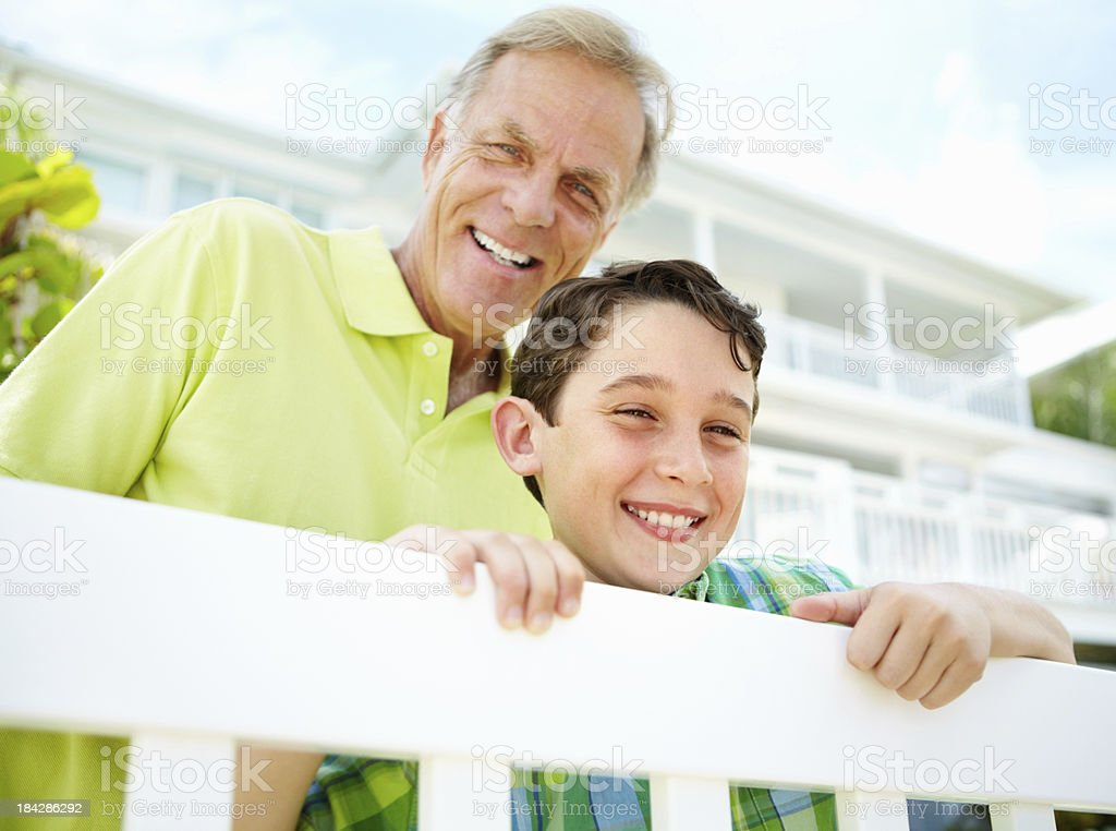 Boy with his grandfather smiling together royalty-free stock photo