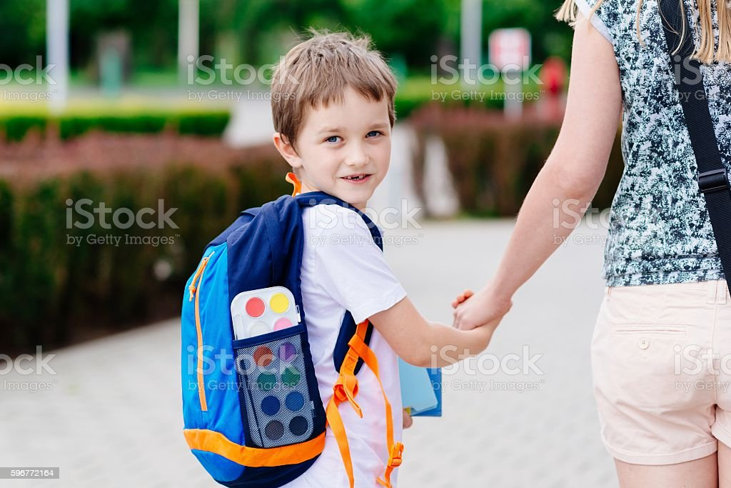 Boy with his mother at road to school. stock photo