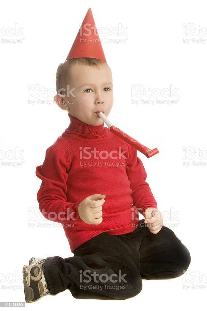 Boy with horn blower. royalty-free stock photo