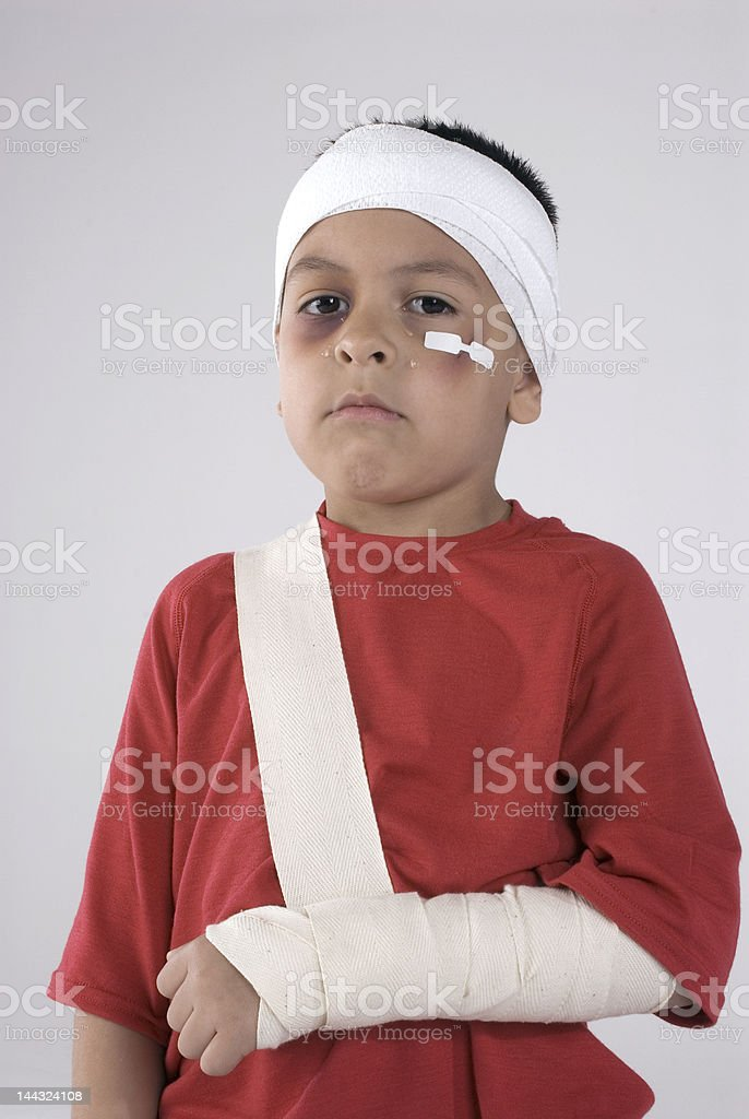 boy with injuries and tears royalty-free stock photo