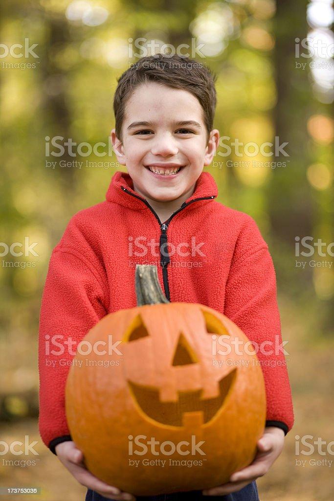 Boy with Jack-o-Lantern stock photo
