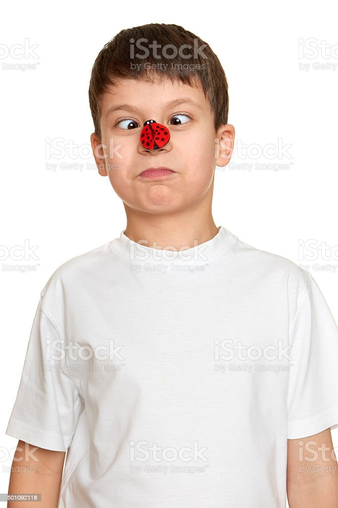 boy with ladybug on nose make faces, fun portrait closeup stock photo