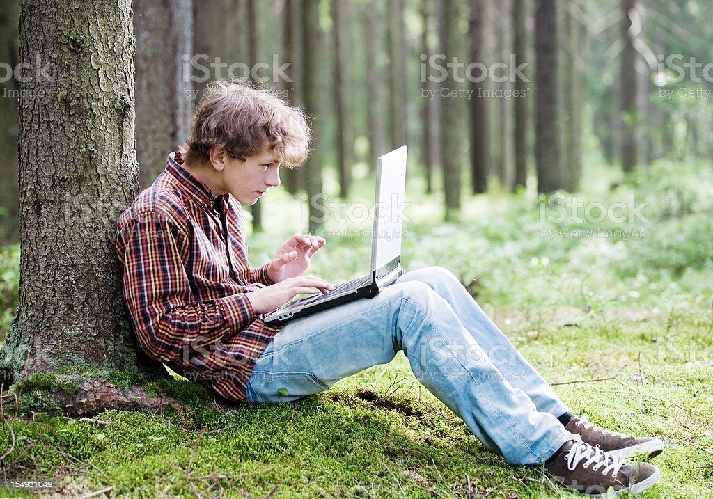 Boy with laptop stock photo