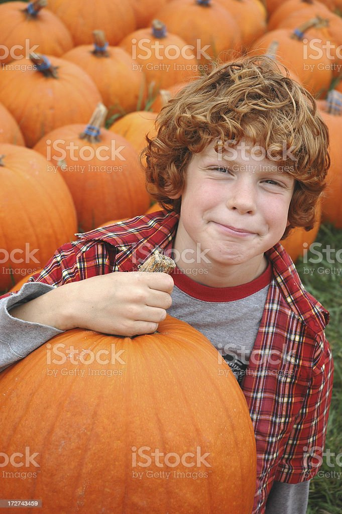 Boy with Large Pumpkin stock photo