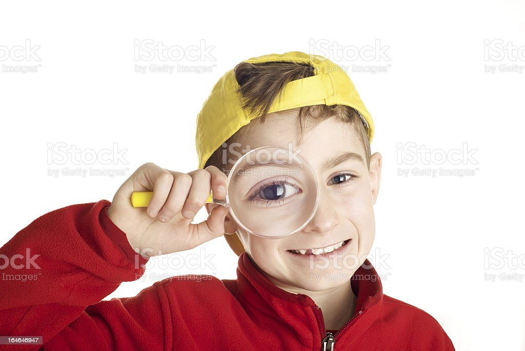 Boy with magnifying glass royalty-free stock photo