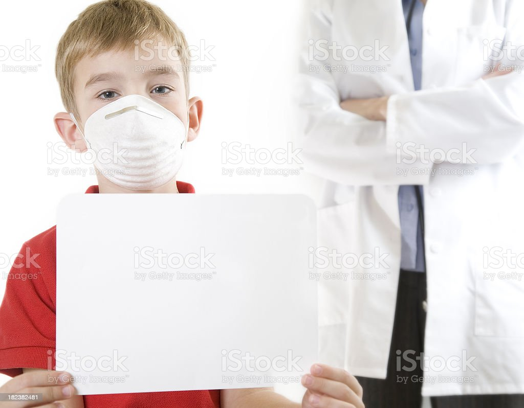 Boy with Mask Holding a Sign in front of Doctor stock photo