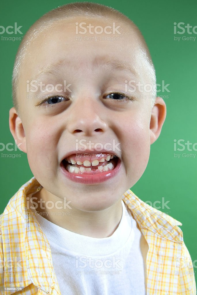 Boy with missing front tooth stock photo