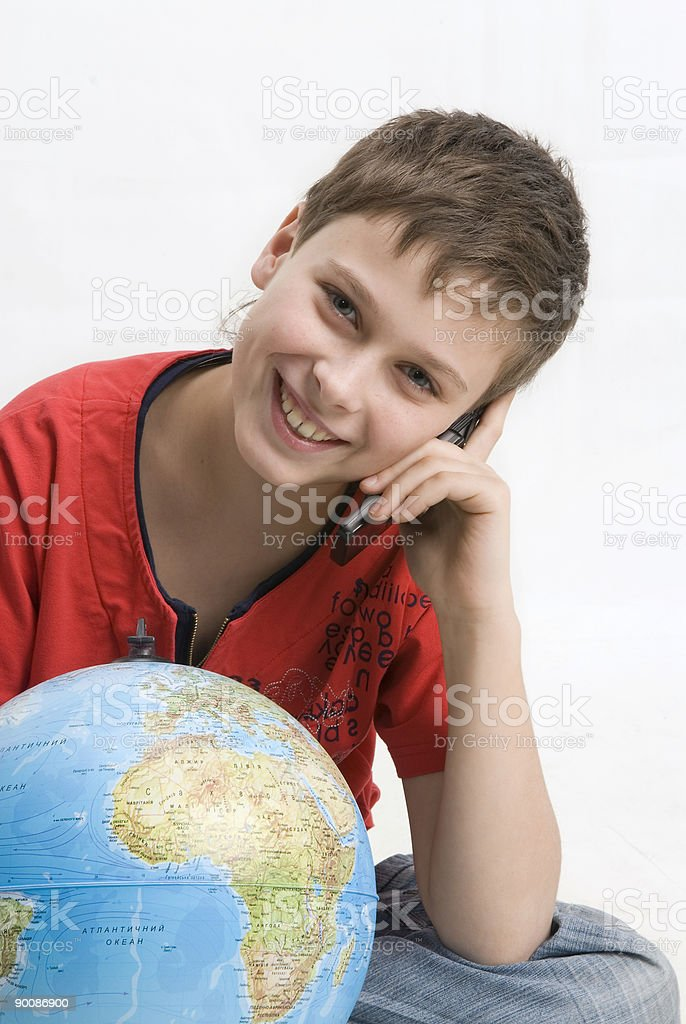 Boy with  mobile phone and  globe on a white background. royalty-free stock photo