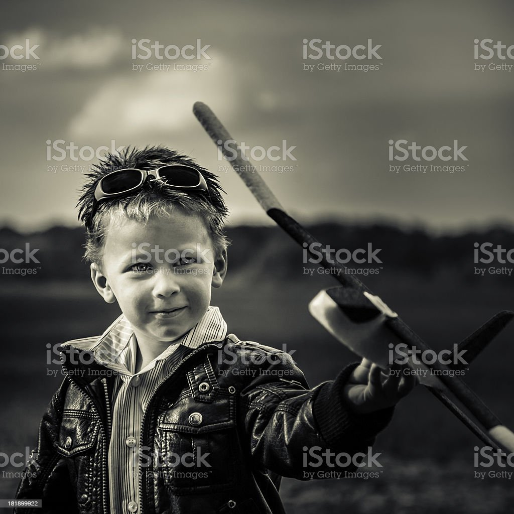 Boy with model air plane stock photo