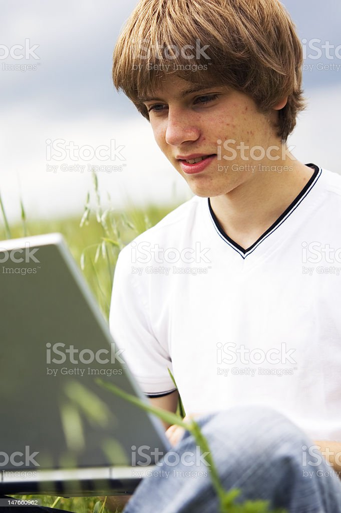 Boy with notebook on the field royalty-free stock photo