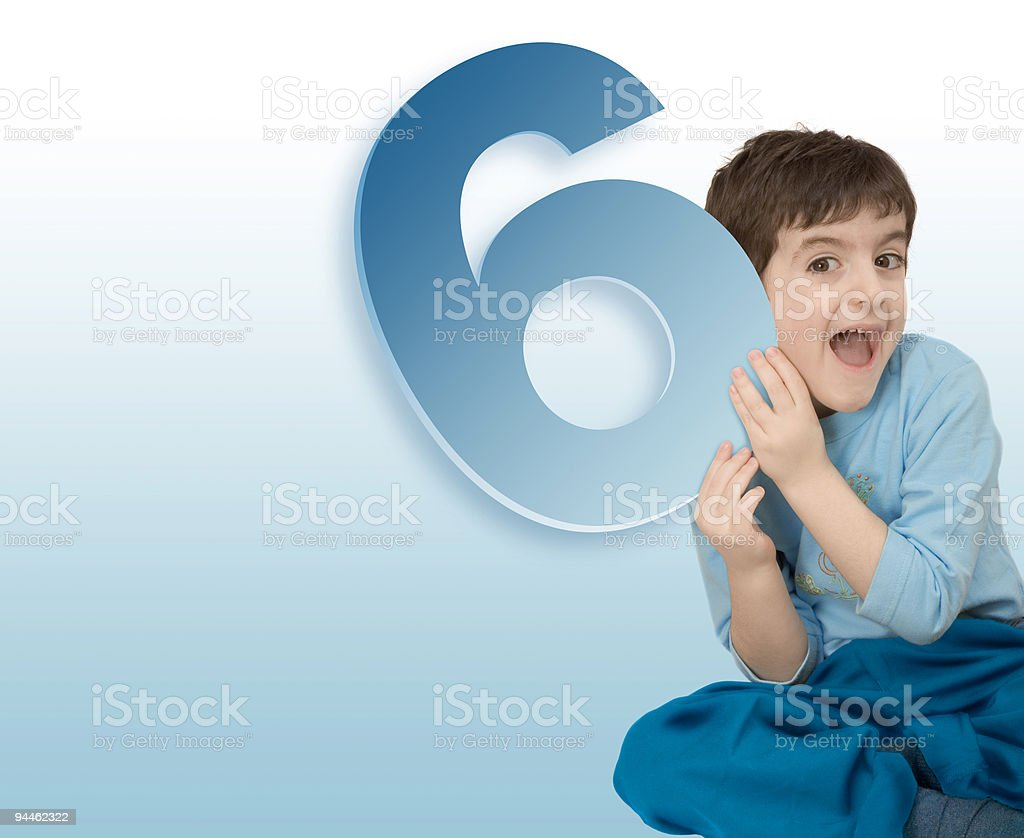 Boy with number 6 royalty-free stock photo