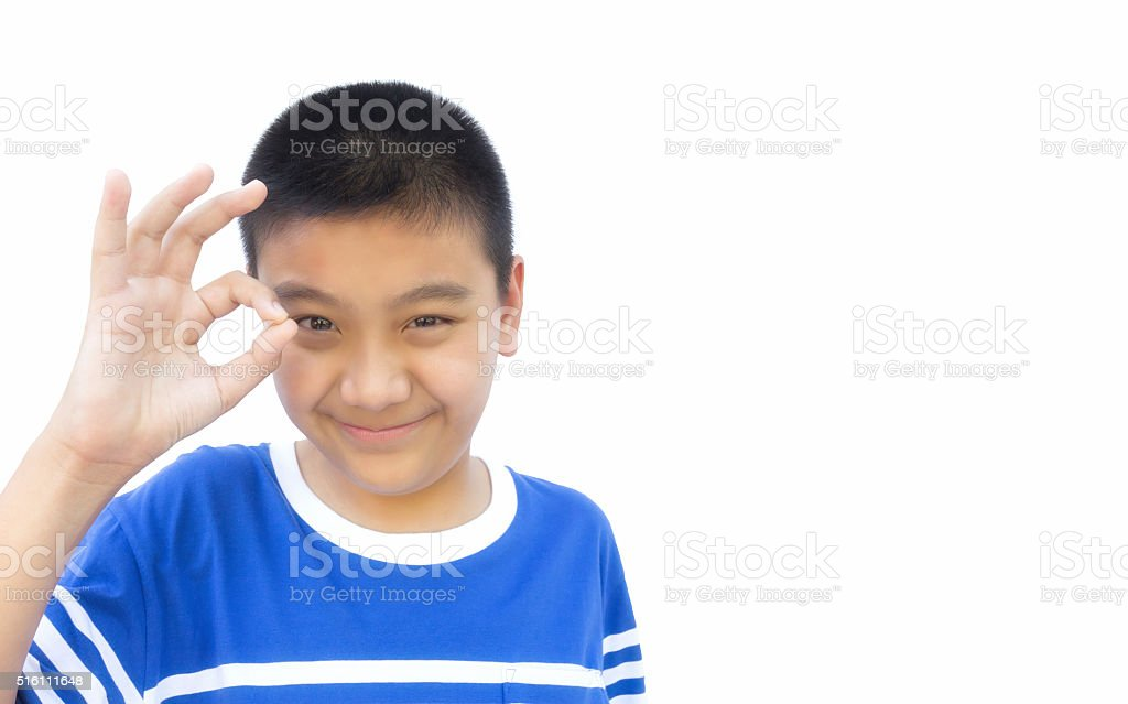 Boy with OK hand sign on isolated background. stock photo