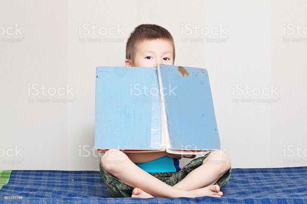 Boy with old vintage fairy tale book stock photo
