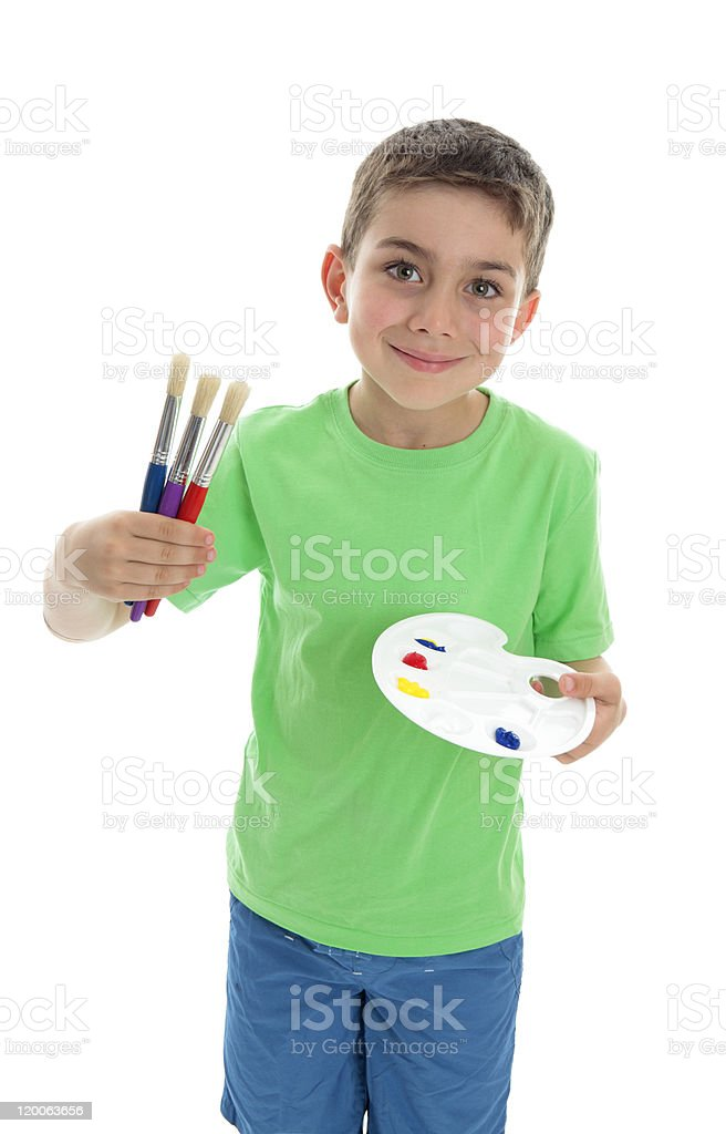 Boy with paintbrushes and artist palette royalty-free stock photo