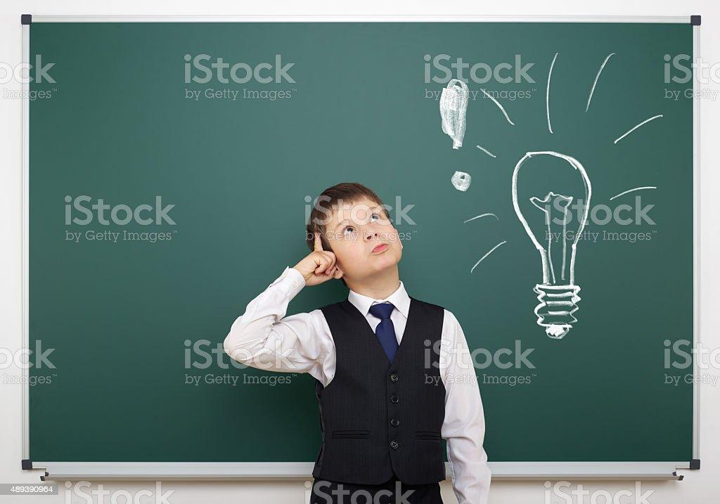 boy with painted bulb having idea stock photo