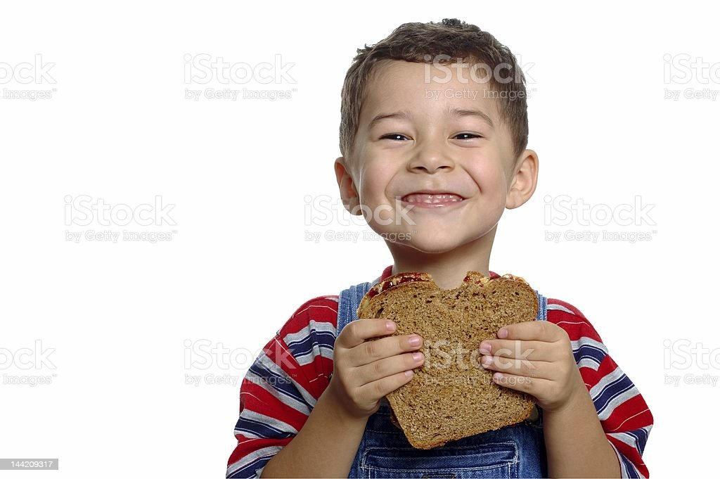 Boy with Peanut Butter and Jelly Sandwich on Whole Wheat stock photo