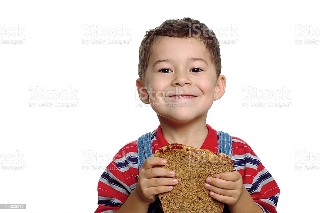 Boy with Peanut Butter and Jelly Sandwich stock photo