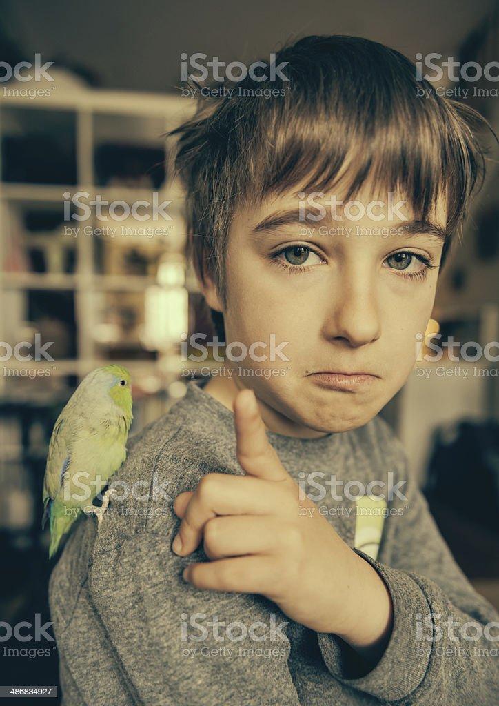 Boy with Pet Bird royalty-free stock photo