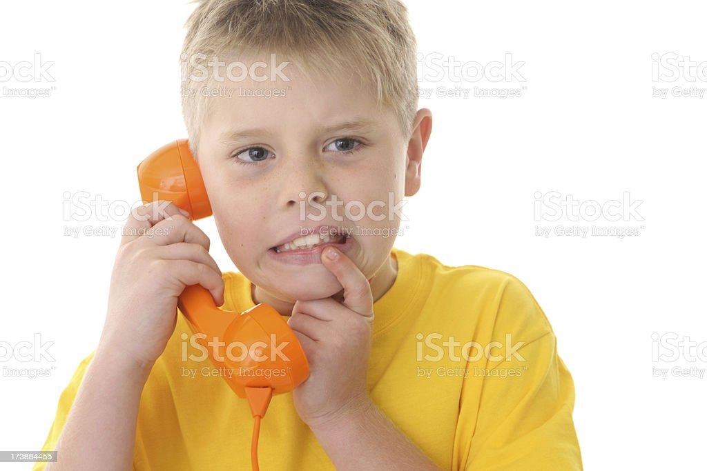 Boy with Phone Looking Worried royalty-free stock photo