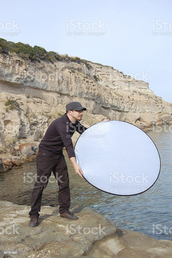 boy with Photography Reflector royalty-free stock photo