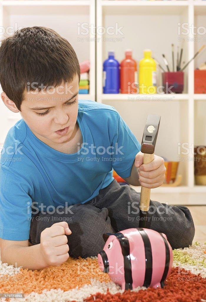 Boy with piggybank royalty-free stock photo