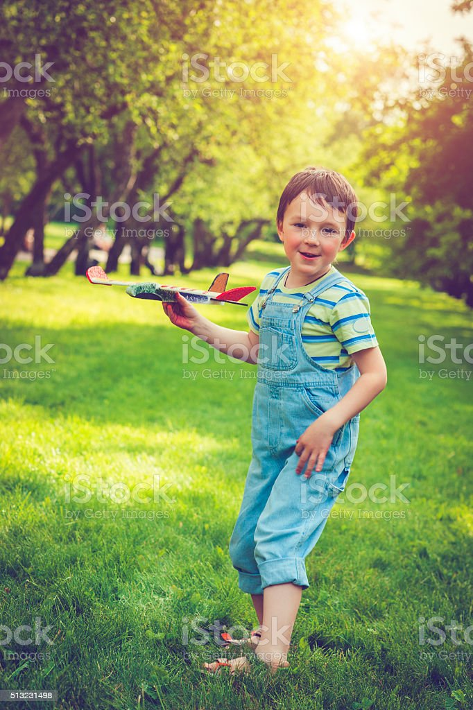 Boy with plane stock photo
