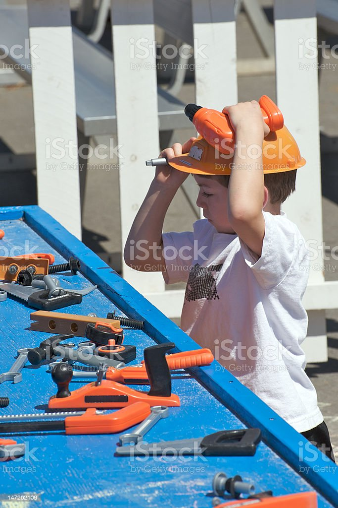 Boy with plastic tools royalty-free stock photo