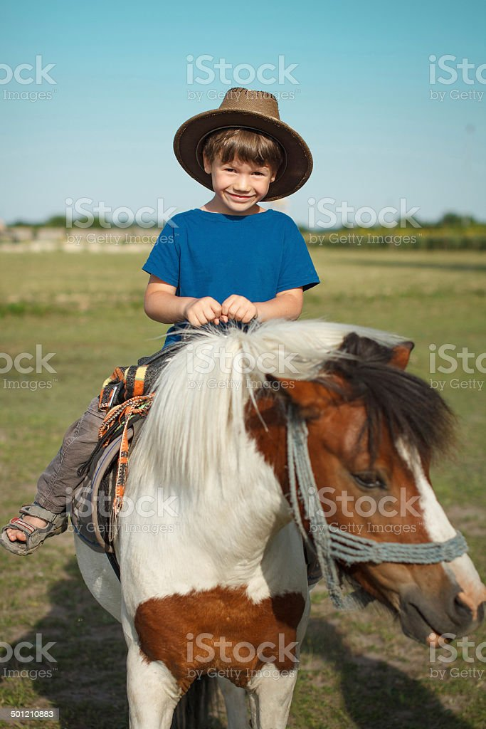 Boy with pony royalty-free stock photo