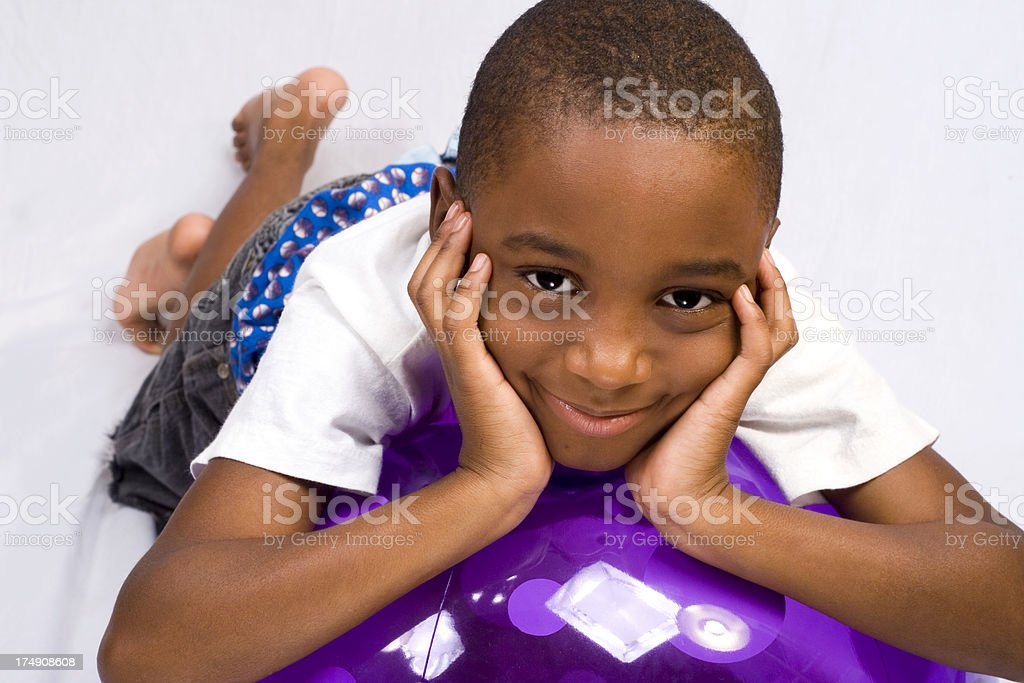 boy with purple ball royalty-free stock photo