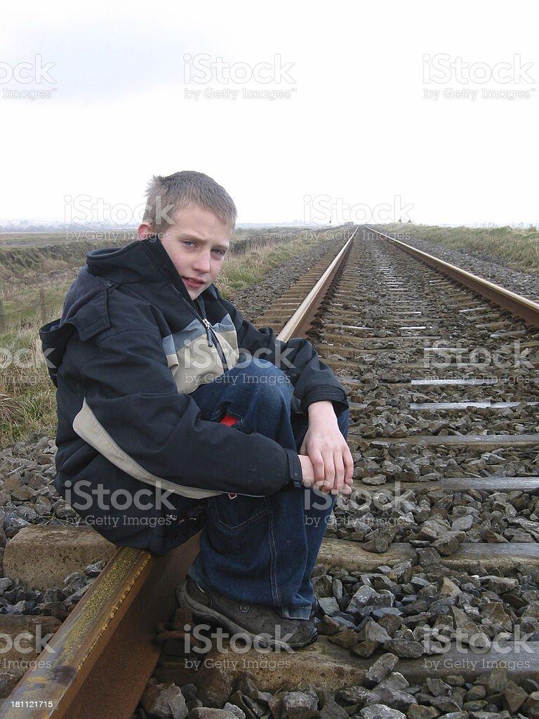 Boy With Railway Into Infinity royalty-free stock photo