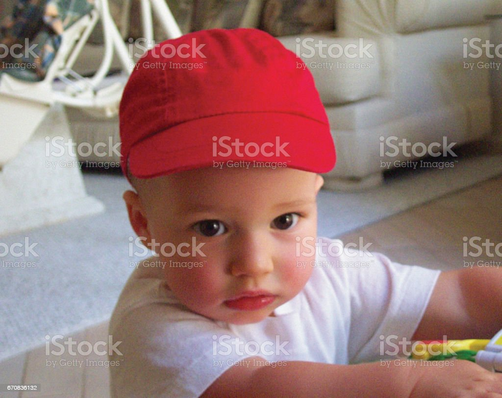 Boy with Red Cap stock photo