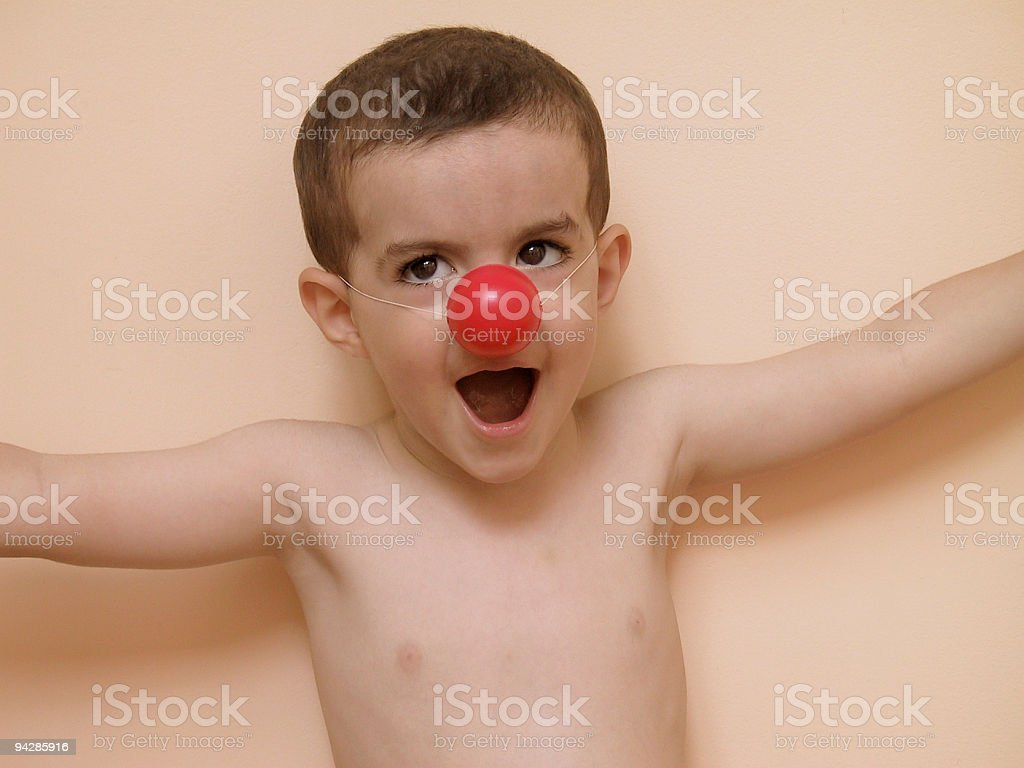 Boy with red clown nose royalty-free stock photo