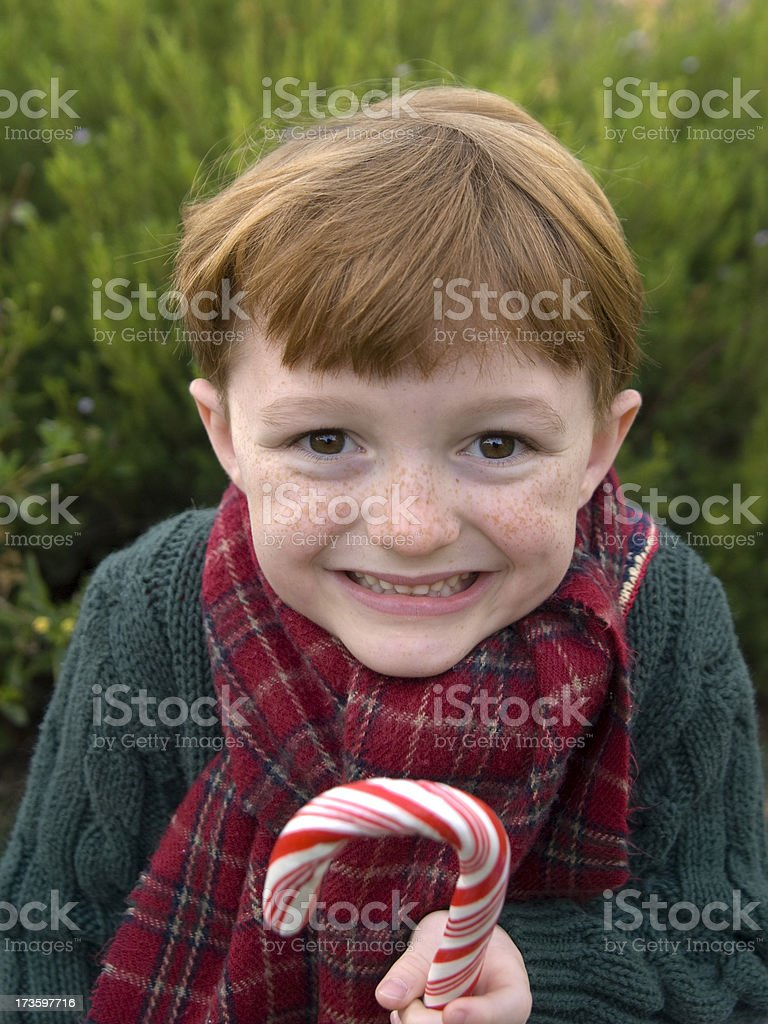 Boy with Red Hair Holding Christmas Candy Cane royalty-free stock photo