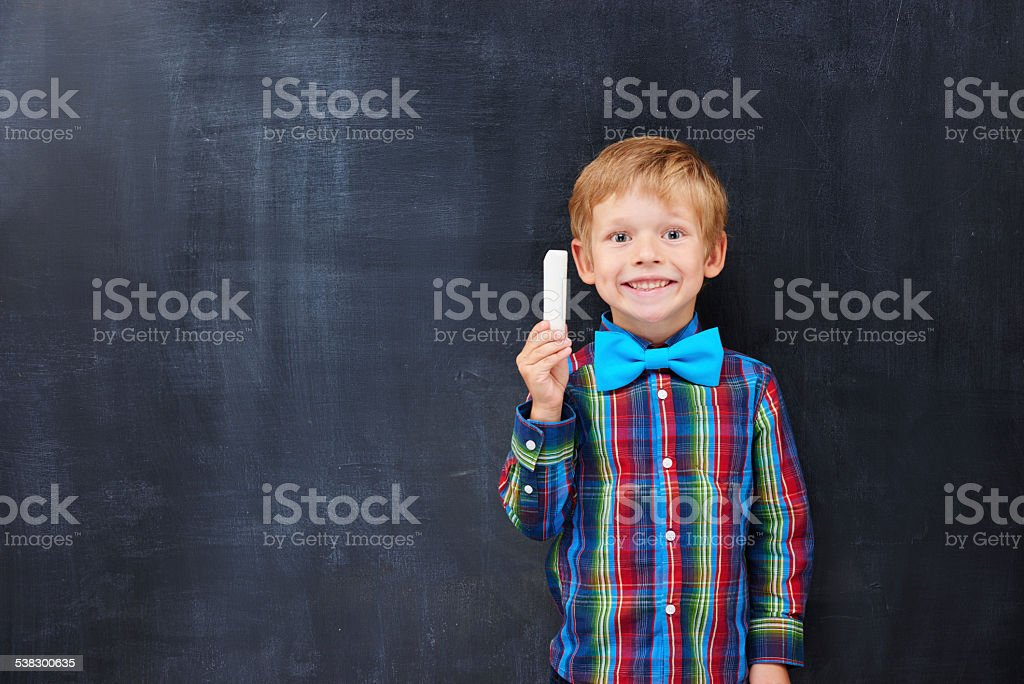 Boy with red hair looking forward far classwork stock photo