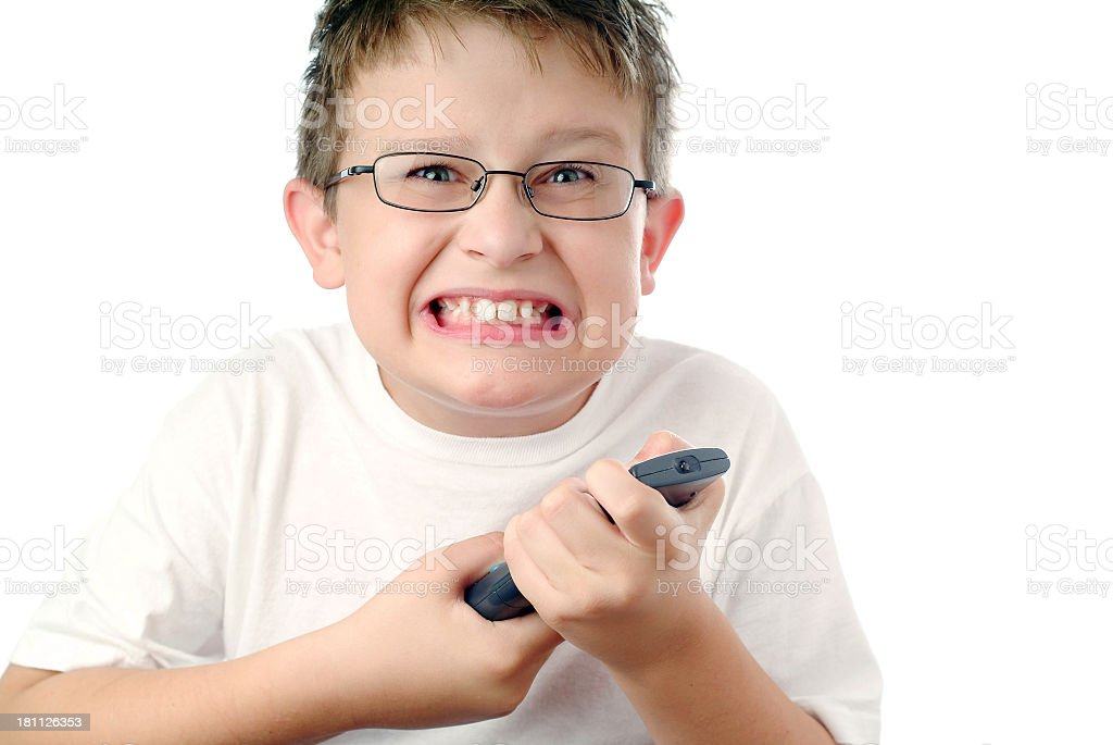 boy with remote – missed my show! royalty-free stock photo