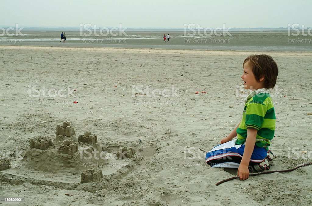 Boy with sandcastle royalty-free stock photo