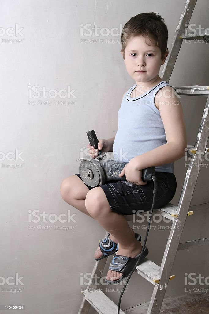 Boy with saw royalty-free stock photo