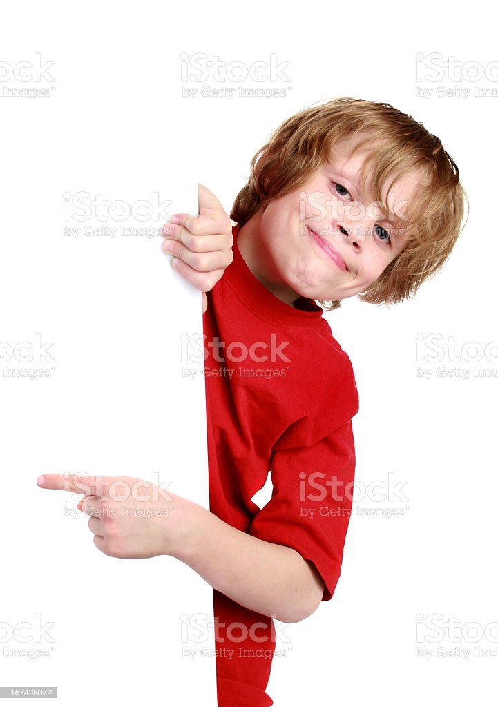 boy with sign pointing royalty-free stock photo